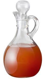 Bouteille en verre avec du vinaigre de cidre de pomme non filtré